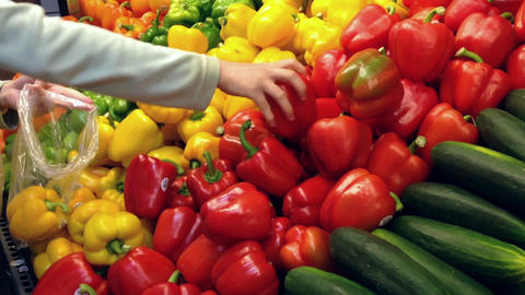 Woman Selecting Fresh Red And Yellow Peppers In Gr stock footage