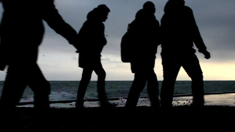Young People Silhouettes On The Beach stock footage