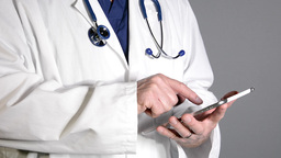 Doctor Using Tablet stock footage