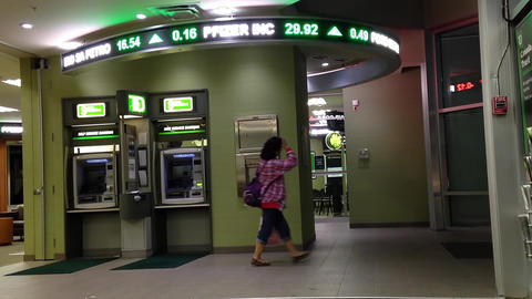 Woman leaving the TD Bank passing by atm machine Footage