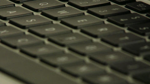 Laptop Keyboard Closeup Rack Focus 1 stock footage