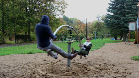 Two Adults Have Fun On The Seesaw Springer 2 stock footage