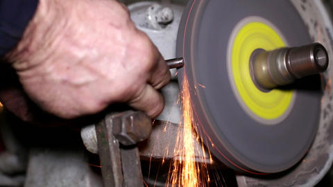 Filing a Piece of Iron with a Rotating Filing Mach Footage