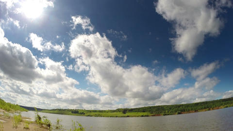 timelapse with clouds moving over river Footage