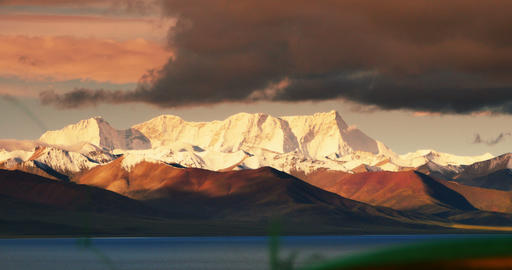 4k Sunrise Huge Clouds Mass Rolling Over Lake Namtso & Snow Mountain In Tibe stock footage