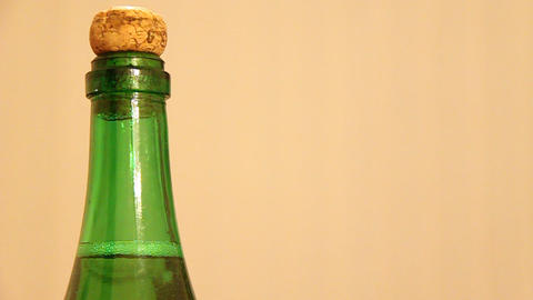 Green bottle on yellow background Footage