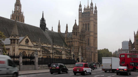 Road Traffic Near Houses Of Parliament In London, England stock footage