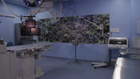 Long shot of the operating room with angiographic scanner (no people) ビデオ