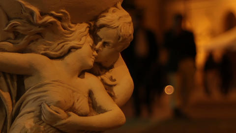 Couple Sculpture And Night People stock footage