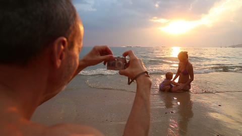 Man Picture Girl Play With Mother On Sunset stock footage