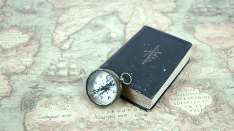 A Compass And A Book On A Map stock footage