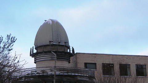 Time lapse clouds running behing observatory dome Footage