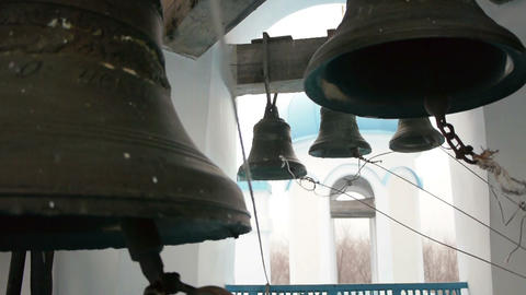 Bells striking by bell ringer in monastery Footage