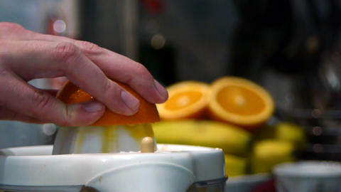 Squeezing Fresh Juice Out Of Ripe Tasty Oranges An stock footage