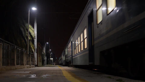 Passenger train leaving at nigth 2748c Footage