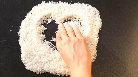 man hand drawing heart on rice Footage
