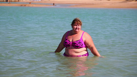 Overweight Woman Bath In Sea stock footage