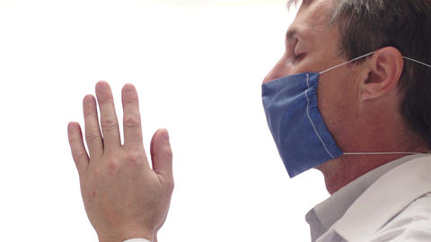 Doctor With Mask Praying Side View stock footage