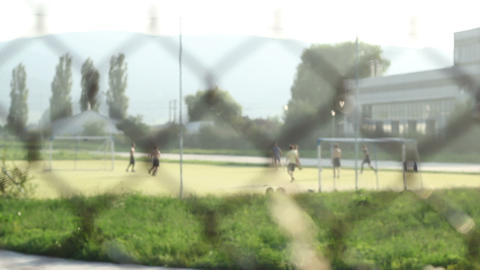 Kids Playing Football After Fence stock footage
