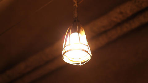 Swaying Lamp In Basement stock footage