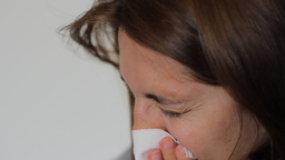 Woman Is Blowing Nose stock footage
