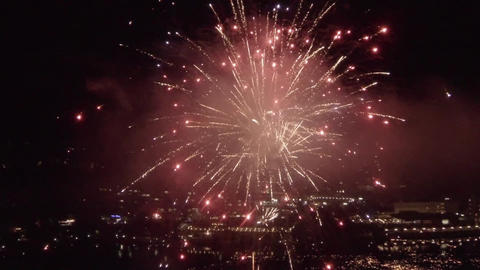 AERIAL SLOW MOTION: Fireworks Above The City stock footage