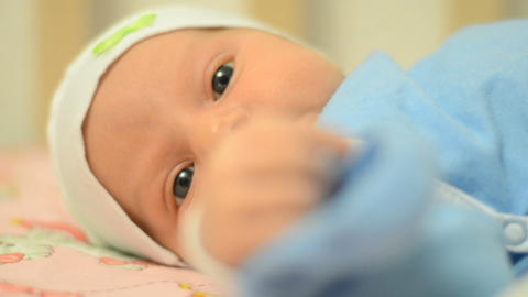 Close-up Portrait Of A Beautiful Newborn Baby, Fir stock footage