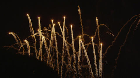 SLOW MOTION: Golden Fireworks Shooting Up In The A stock footage
