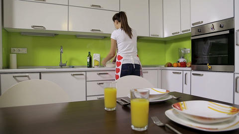 Girl In The Kitchen stock footage