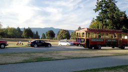 One side of Stanley park with tourist bus passing  Footage