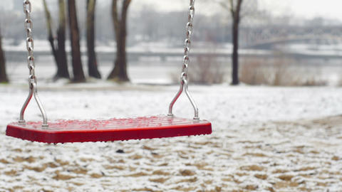 Red Empty Swing During The Winter stock footage