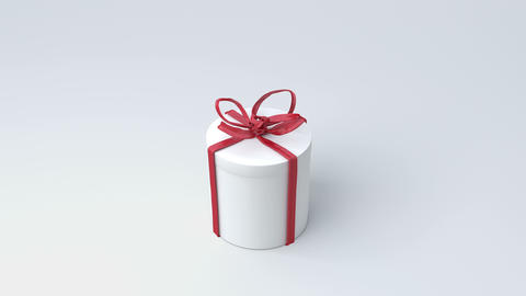 White gift box, cylinder with red ribbon closing. Tying bows CG動画素材