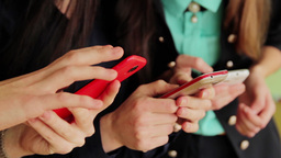 1709 Group Of Girls Show Pictures On Mobile Phones stock footage