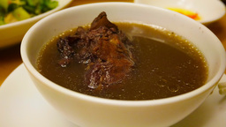 4k UHD Time Lapse Video Of Eating Black Bean Soup With Pig Trotters stock footage
