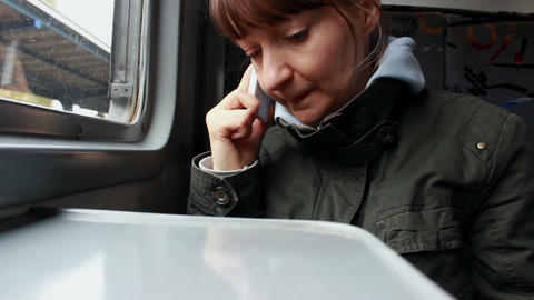 Woman Talking On The Phone In A Train stock footage
