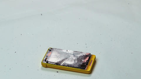 Destruction Of A Cell Phone With A Hammer stock footage