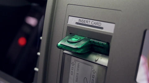 Detail Of Woman's Hand Inserting A Bank Card At An stock footage