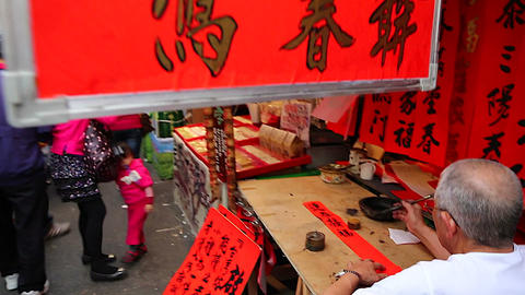 Man writing chinese at Chinese new year market Footage