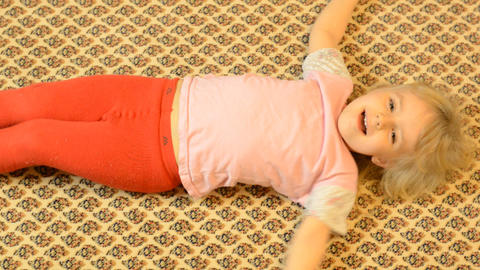 Happy Child Lying On A Carpet, Crazy Emotions stock footage