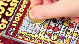 Close Up Woman Scratching Lottery Ticket stock footage