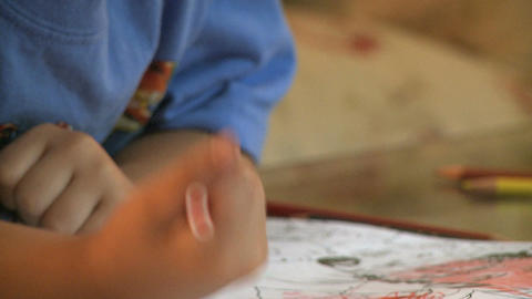 Child Using Colored Pencils stock footage
