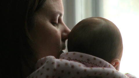 Mother Holds Her Baby Girl Win stock footage