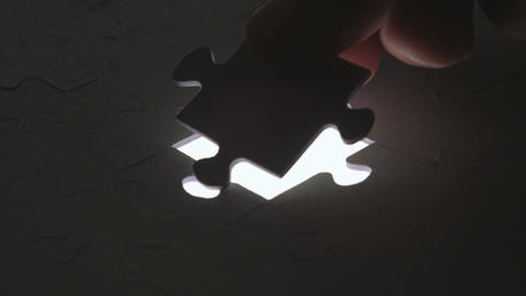 Last Piece Of Jigsaw Puzzle With Silhouette Light stock footage