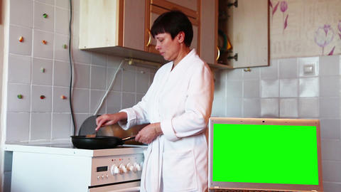 Woman prepares food in the kitchen. Green screen Footage