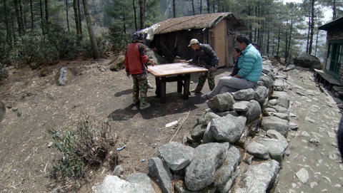 EVEREST AREA, NEPAL - MARCH, 2014: 2.7K. Nepalis Playing A Board Game Carrom On  stock footage