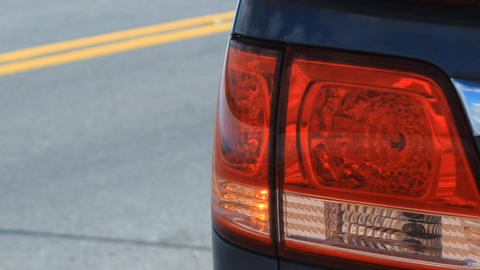Tail Light Flashing On Side Of Road stock footage