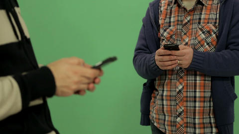 Two men using smartphone - rack focus Footage
