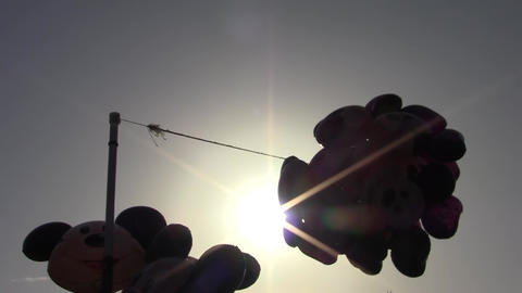 Helium Balloons Hanging From The A Pillar In The Beating Wind 01 stock footage
