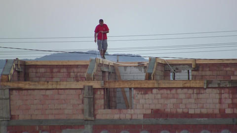 Worker Who Wet Concrete Of A House Under Construction 02 stock footage