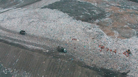 Aerial Shot Landfill With Working Trucks And Tractor stock footage